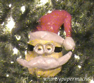 Minion Bob Santa Ornament hanging on the tree