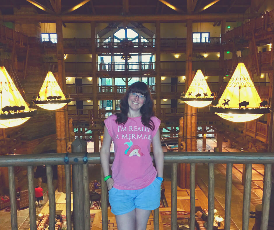 Morgan Prince wearing blue shorts and a pink t-shirt in Walt Disney World to cope with the heat.