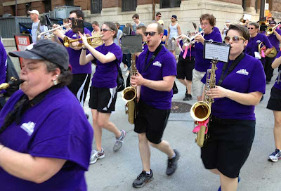 Minnesota Freedom Band marching, purple t-shirts