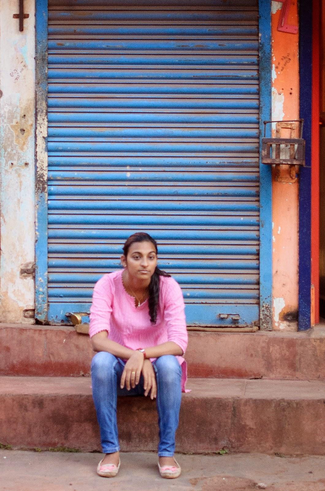 Viola waiting at Shivanna's Charmuri Stall