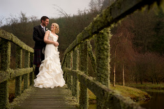 Wedding photo of bride and groom on Scottish bridge