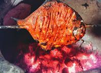 Pomfret cooking in Ovalclay Tandoor for Tandoori Pomfret Recipe