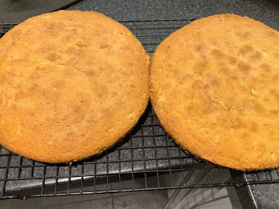 Two sponge cakes on a cooling rack
