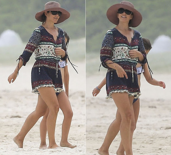 Crown Princess Mary of Denmark hits the beach again in Byron Bay. Walking barefoot along the sand she was accompanied by eight-year-old daughter Princess Isabella