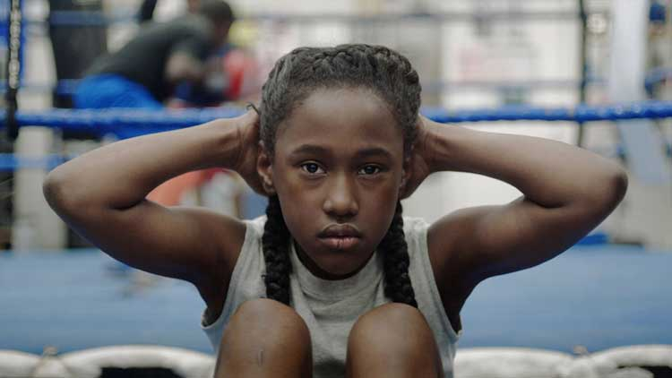 Royalty Hightower plays Toni, a young girl who starts with boxing and moves onto dance.
