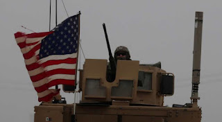 US flag flies in Syria's Manbij despite pullout notic
