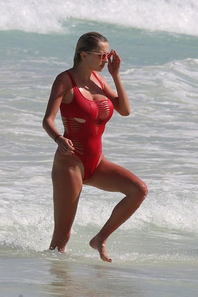 Caroline Vreeland in Red Swimsuit at Tulum Beach, Mexico