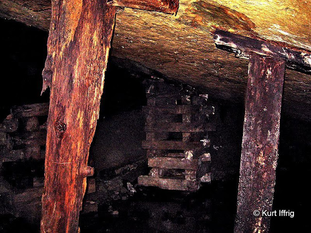Further back in the mine there are huge rooms supported by these wooden beams.