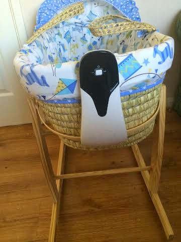 Babysense sensor pad on end of a moses basket