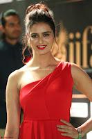 Meenakshi Dixit in Red One Shoulder Red Zipped up gown at IIFA Utsavam Award 60.JPG