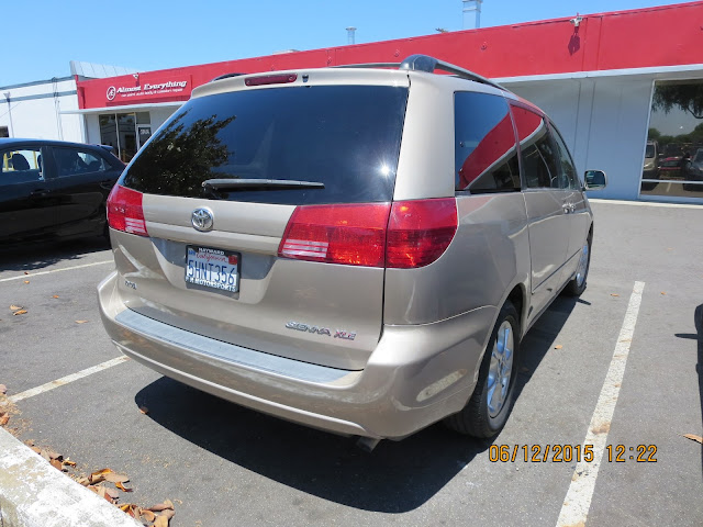 Dented & scraped Toyota Sienna after collision repair.