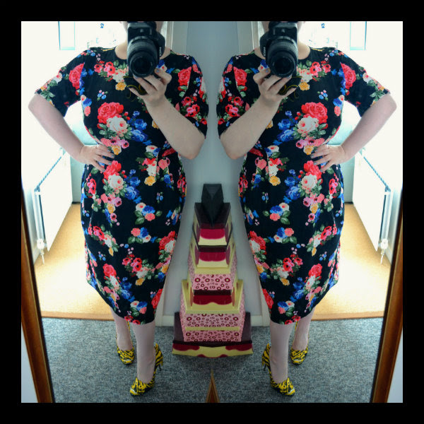 wearing asos floral wiggle dress and moschino tiger shoes