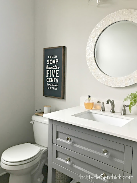 gray vanity round mirror bathroom