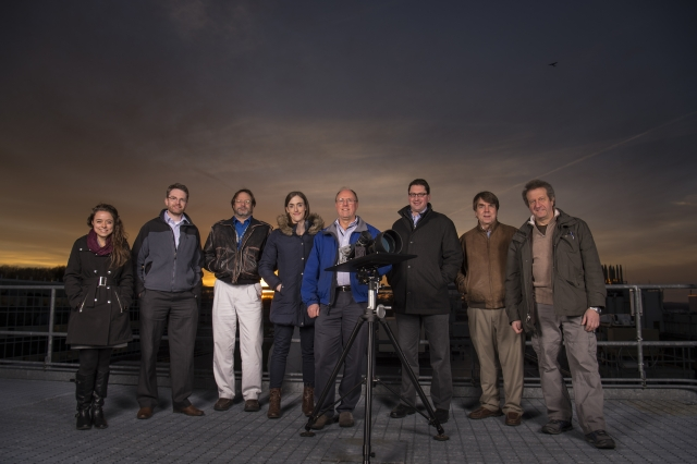Image Attribute: Lincoln Laboratory researchers pose with the LASSOS sensors: (l-r) Emily Clemons, Tom Reynolds, and Brad Crowe of the Air Traffic Control Systems Group; Erin Tomlinson, Rich Westhoff, Brian Saar, Michael Joffe, and John Flint of the Laser Technology and Applications Group. / Photo: Glen Cooper, MIT News
