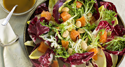 This salad has macron almonds, oranges, and other vegetables with a sweet dressing.