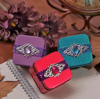 http://www.specialgiftboxes.com/product/nice-metal-favor-tin-with-heart-and-sash-set-of-6/