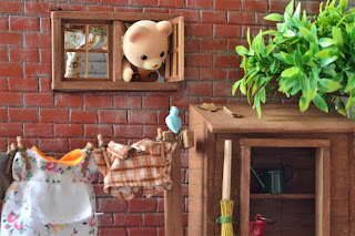Sylvanian Families brother Aidan Osborne bear says hello to little blue bird