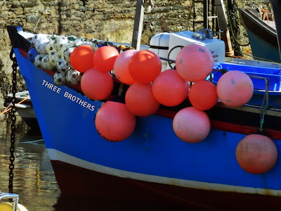 Fishing boat with colourful floats