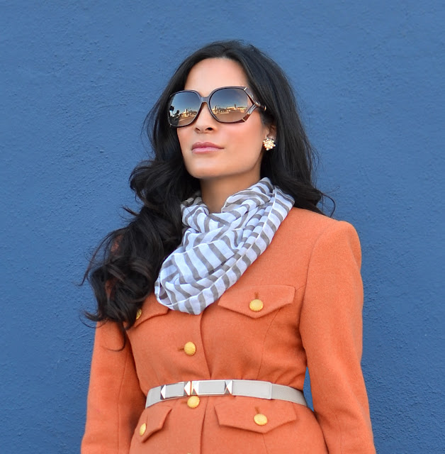 pumpkin spice orange vintage suit, striped scarf, gucci glasses