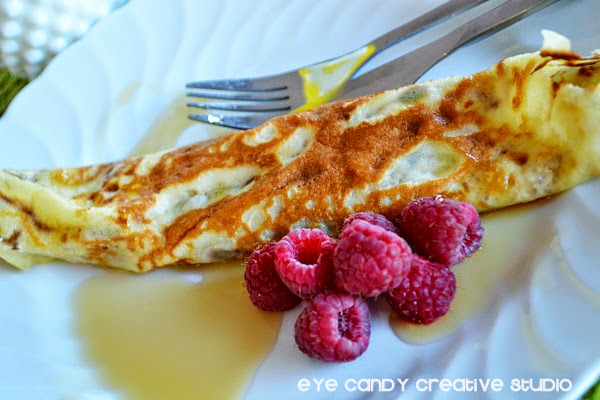 roll crepe with maple syrup, fruit, whipped cream, any toppings