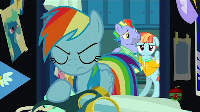 An angry Rainbow looks in her locker, her unhappy parents in the background