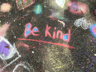 chalk drawing with the words Be Kind