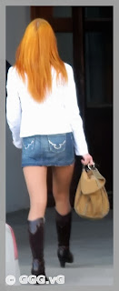 Girl in jean mini skirt on high heels