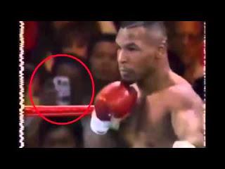 VIAJERO DEL TIEMPO USANDO UN SMARTPHONE EN PELEA DE MIKE TYSON EN 1995 (VIDEO)