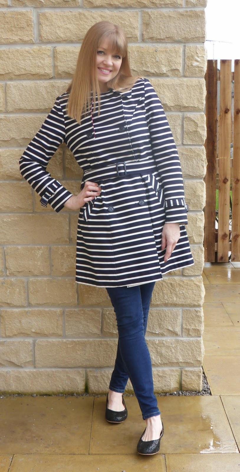 Over 40s blogger What Lizzy Loves wearing navy and white striped trench coat from Laura Ashley with skinny jeans and black ballerina shoes
