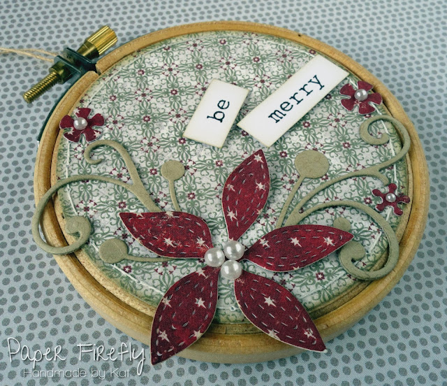 Embroidery hoop Christmas decoration with poinsettia in traditional colours