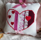 HEARTS & SWIRLS CROSS STITCH PILLOW.