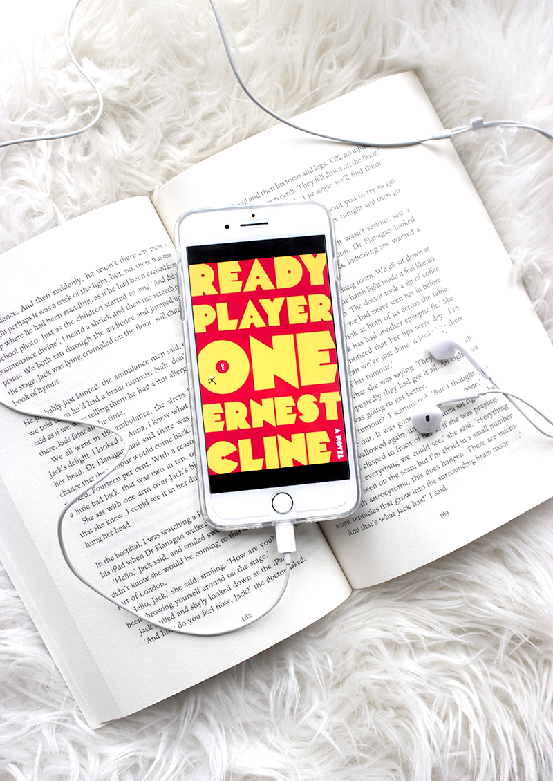 a review on the movie and book Ready Player One by Ernest Cline directed by Steven Spielberg iphone flatlay we own the sky luke allnutt art3mis parzival aech shoto dito halliday