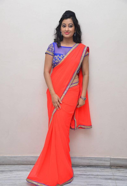 South Indian Hot Girl Tejaswini Prakash Hip Navel In Designer Orange Saree