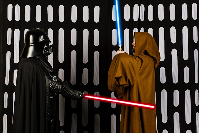 Darth Vader about to slice through Obi-wan Kenobi