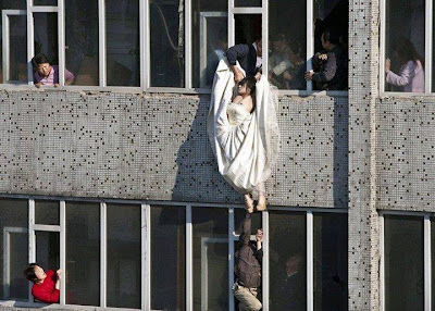 This Lady Jumps From 7Storey Building With Wedding Gown B'cos Her Lover Call It Quit