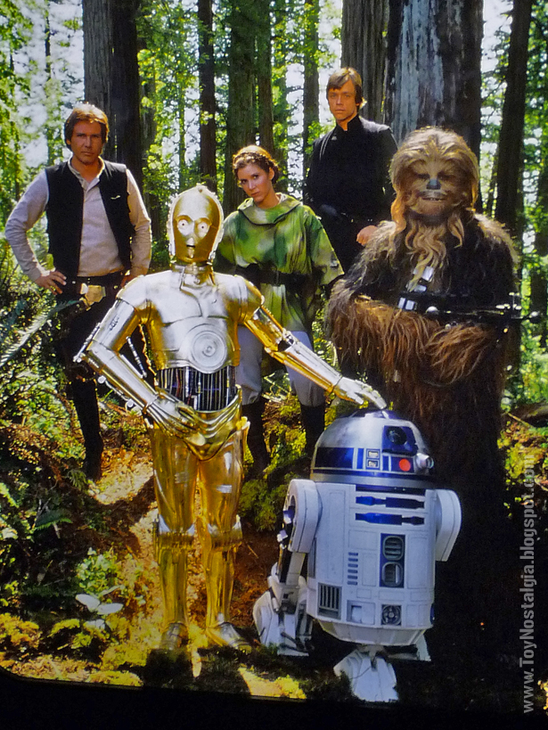 """Harrison Ford (Han Solo), Carrie Fisher (Princesa Leia),  Mark Hamill (Luke Skywalker), Peter Mayhew (Chewbacca),  Anthony Daniels (C3·PO), Kenny Baker (R2-D2)  """"Episodio VI - The Return Of the Jedi""""  (STAR WARS - The Exhibition)"""