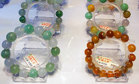 jadeite bracelets with redcolors in a high end jade shop