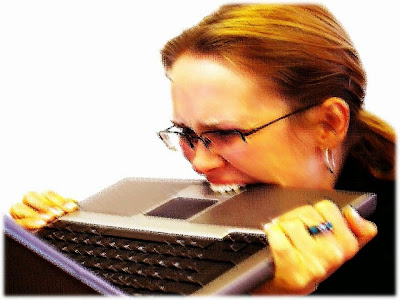 frustrated woman chewing laptop