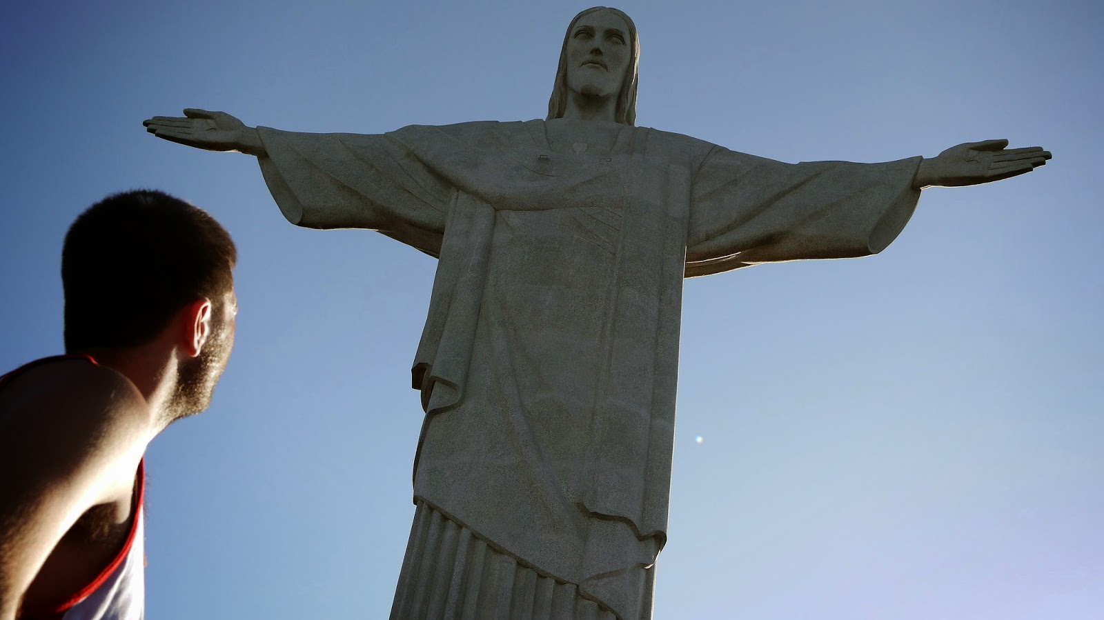 Guy looking at Christ the Redeemer Rio de Janeiro