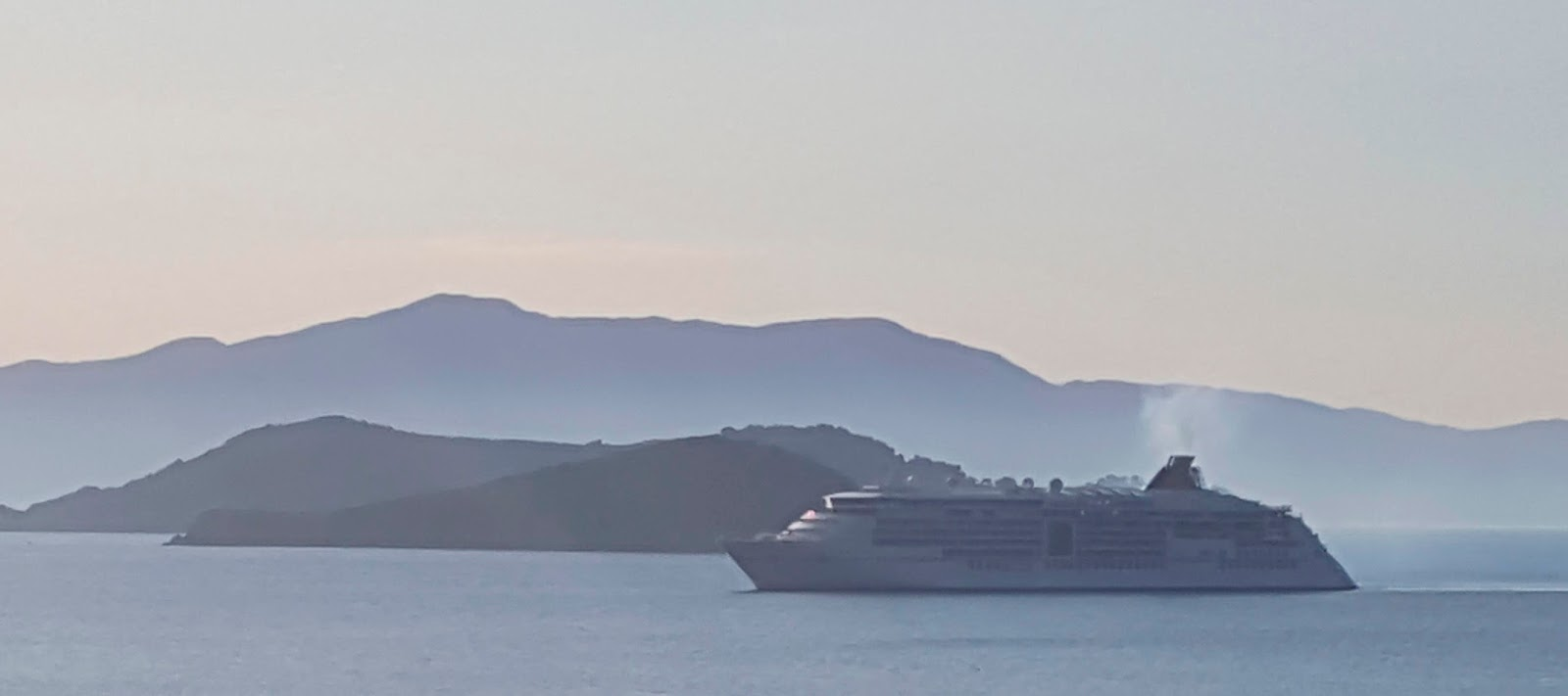 In front of an island, Europa 2 cruise liner in the bay of Skiathos, Greece