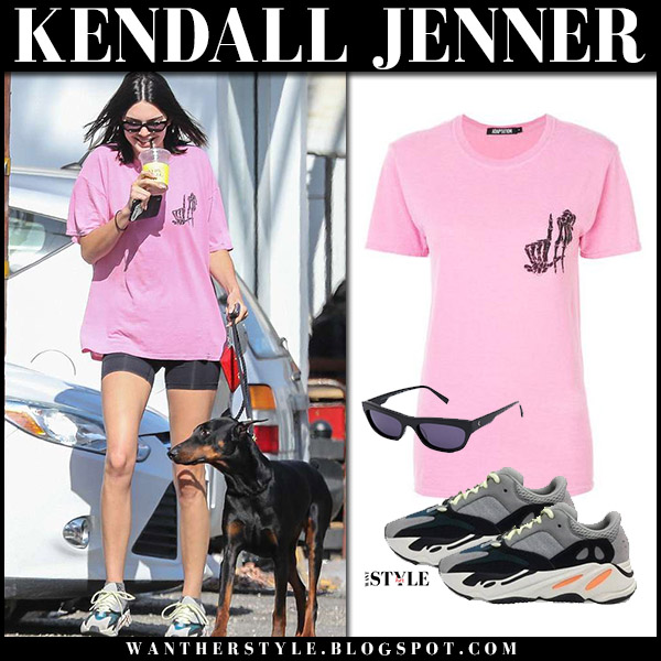 Kendall Jenner in pink t-shirt adaptation and sneakers yeezy model style april 23
