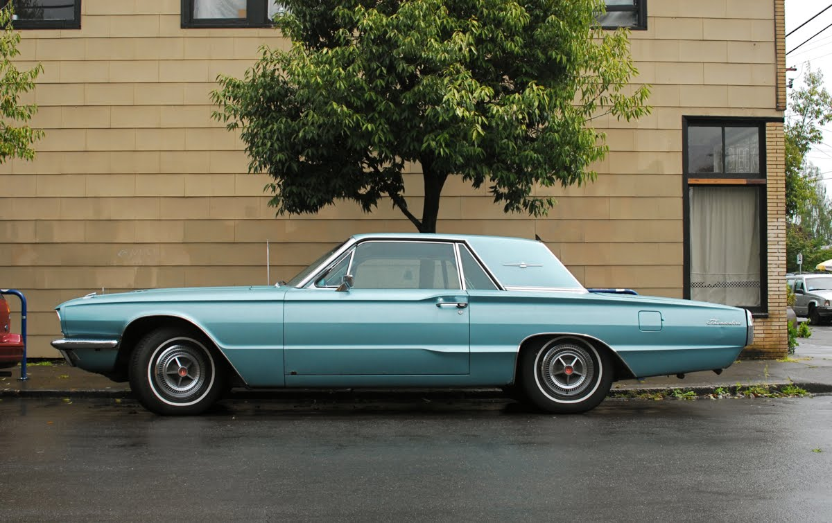 OLD PARKED CARS.: 1966 Ford Thunderbird.