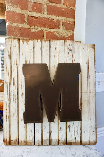 Vintage wood with a metal letter M