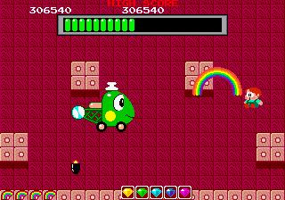 Captura del arcade Rainbow Islands que muestra al segundo jefe, una especie de helicóptero con cara de gusano verdoso