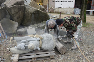 Drilling holes in sculpture base for secure installation Cava Nardini Vellano Tuscany Italy