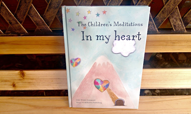 The Children's Meditations in my Heart book, resting on a bench.