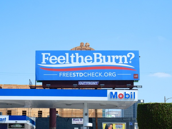 Feel the Burn STD check billboard