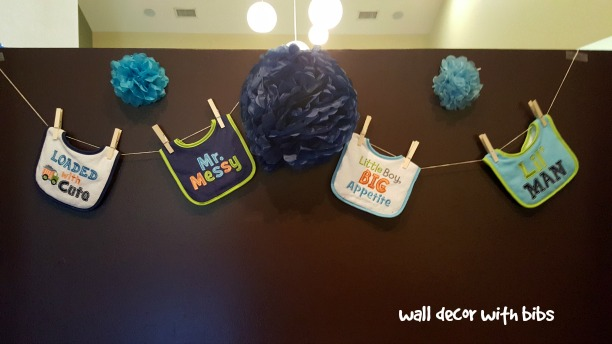 little man baby shower wall decor with bibs