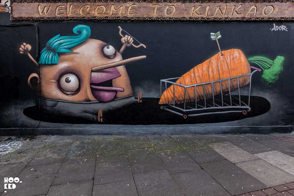 French street artist Ador paints a new mural on Pedley Street, London