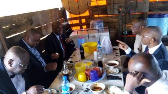Photos: Fmr Abia state Gov. Orji Uzor Kalu & his friends stop to eat at a road side buka